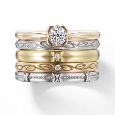 フェミニン 婚約指輪の白い花